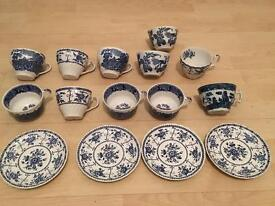 Assorted collection of blue and white cups and saucers.