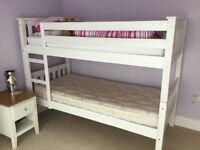 White wooden bunkbeds