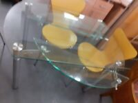 Very unusual glass dining table with folding in sides to make it round