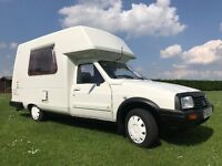 AMAZING LITTLE CAMPER FULLY PREPARED AND READY FOR SUMMER ADVENTURES! LOW MILEAGE ROMAHOME CAMPERVAN