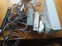 Wii console + cables + Controller + sensor bar