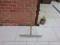 Landscape gardeners rake