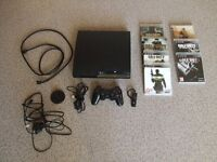 Sony Playstation 3 Charcoal Black Blu-Ray 120GB Chargeable Earpiece + 1 Controller + 7 Games.