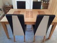 Solid Wooden Table With Four Faux Brown Chairs