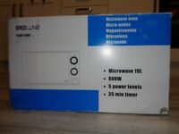 Brand new, never used still in the box, PRO-LINE Microwave Oven