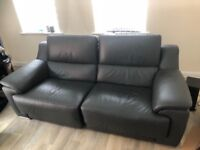 Grey electric reclining leather sofa