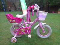 """Girls 12"""" Pink Bike in very good condition with stabilisers, basket, doll carrier & bell."""