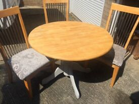 Pine round dining table and 3 chairs
