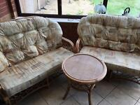 Two 2 seater Wicker Conservatory/Summer house furniture with matching table
