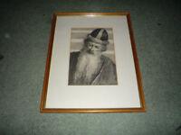 Four charcoal framed portraits