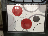 Striking black, red, grey and white circle picture