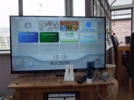 Boxed Nintendo Wii bundle with games