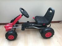 Black and red go kart.