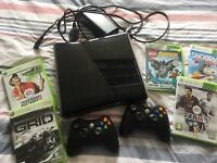 Xbox 360 with 5 games two controllers