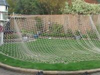 two 24 ft goal nets in reasonable condition with the yellow clips