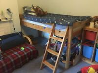 Mid-height solid pine bed with ladder