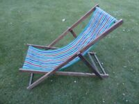Traditional style wooden framed deck chair.