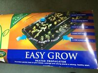 Used (for one season) easy grow heated propagator in good condition