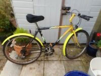vintage mans yellow and black apollo atomic 20 inch frame bike with lock