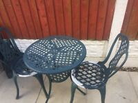 Cast iron 2 chairs table