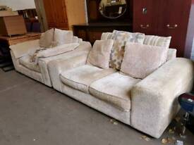 Large beige fabric two seater and cuddle chair suite
