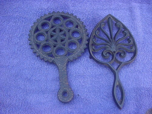 TWO VINTAGE CAST IRON TRIVETS