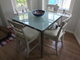 Chrome glass table with four chairs