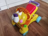 Fisher price walker /ride on lion