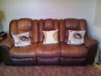 Sofa. 3 seater brown leather recliner settee with 2 seats reclining. Matching 2 seater also .