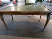 Wooden coffee table with green leather inset top