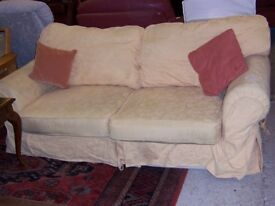 Yellow sofabed at Cambridge Re-Use (cambridge reuse)