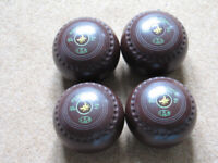A set of four Drakes Pride Professional flat green bowls size/weight 4 Heavy. WB20