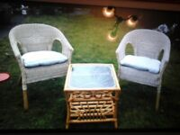 CANE TABLE AND TWO CHAIRS FANTASTIC CONDITION THEY ARE NOT WHITE