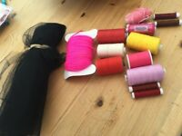 Large piece of black netting, roll of pink wool & various colours of thread, 1 roll is wrapped as b