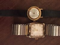 One Smiths watch and one Elgin watch
