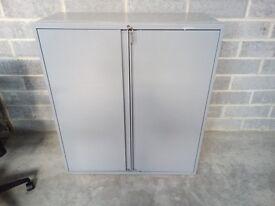 1100x1000x460mm two door steel cupboard in grey, with 2 shelves and keys. £95.00