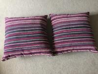 Two purple/pink stripe velour cushions