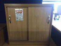 Sliding Door Cupboard, Finished In Oak. 760mm Width x 460mm Depth x 730mm Height.