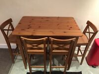Wood kitchen/dining table with four chairs. Good condition. Pick up from Glasgow city centre.