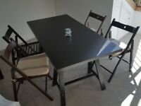 Dark brown table with 4 chairs.