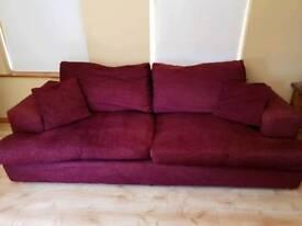 Wine coloured fabric sofa