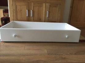 Storage drawer on castors. Ideal for under bed.