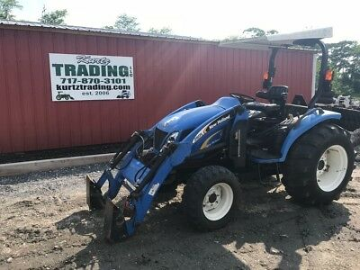 2012 New Holland T2320 4x4 Compact Tractor W Loader.