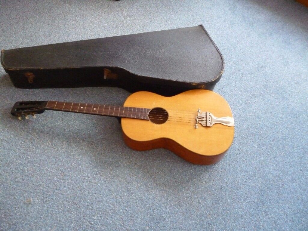 VINTAGE GUITAR WITH A LEATHER BOX CASE