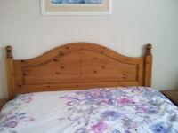 carved pine headboard