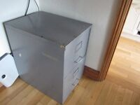 Two drawer lockable finding cabinet.