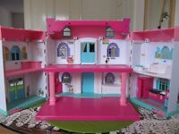 a lovely dolls house for children with sound and lights effects