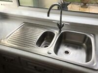 One and a half bowl stainless steel sink and tap