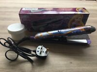 Disney Princess Rapunzel hair straighteners/crimpers. Boxed in as new condition