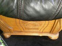 2 three seater Black leather oak surround sofas very comfortable .